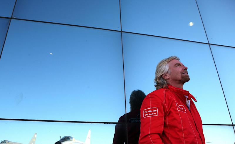 Billionaire entrepreneur Richard Branson says he's 'neck and neck' with Bezos in the space race