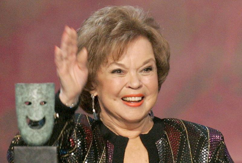 File photo of Shirley Temple Black waving as she is honored at the 12th annual Screen Actors Guild Awards in Los Angeles