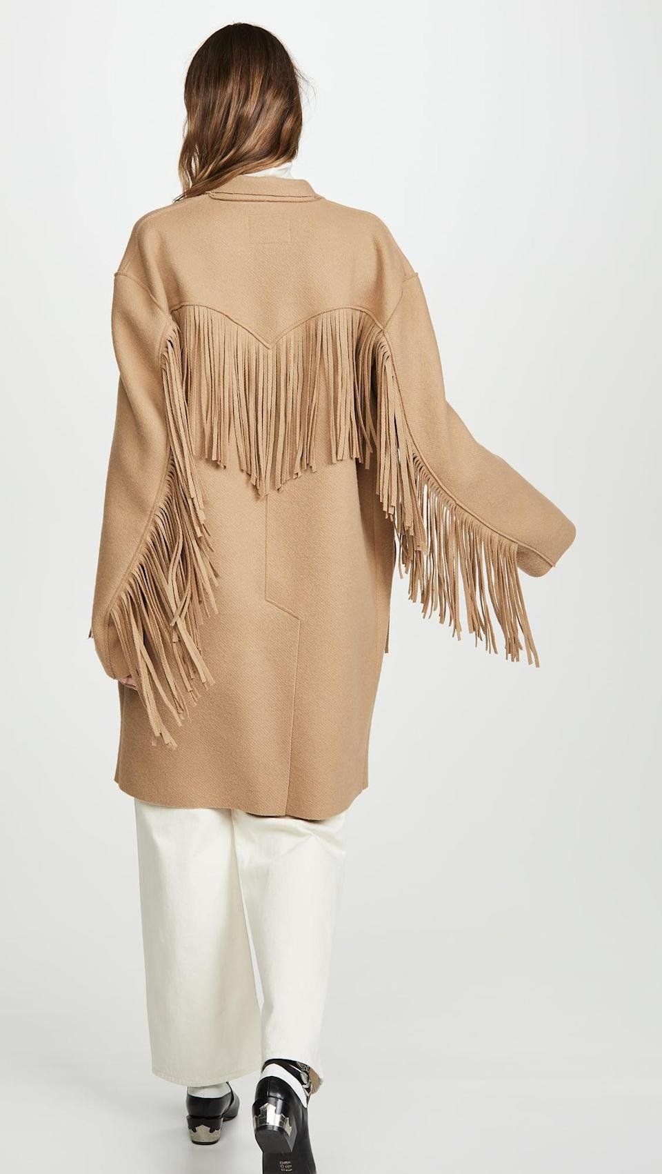 <p>This <span>R13 Fringe Raw Cut Coat</span> ($1,595) is the coat we're dreaming of right now. It's so cool, and we like it paired with light, tonal colors.</p>