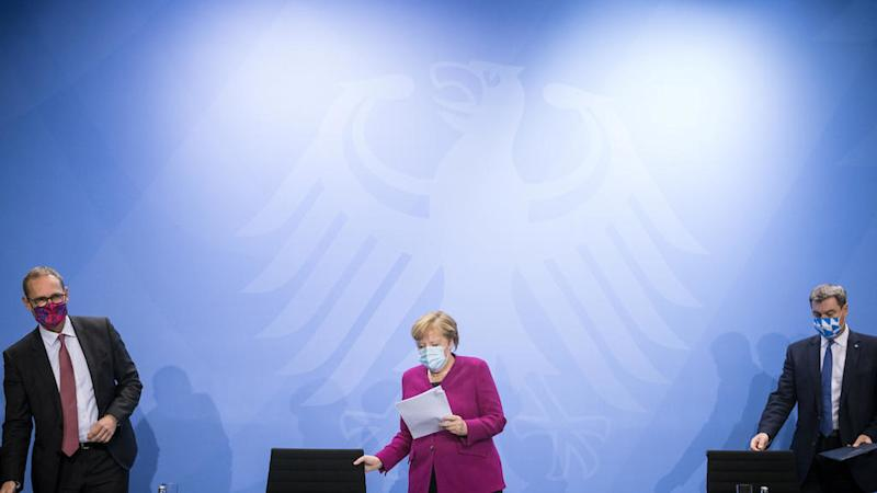Germany tightens Covid-19 restrictions, and Merkel warns more may be needed