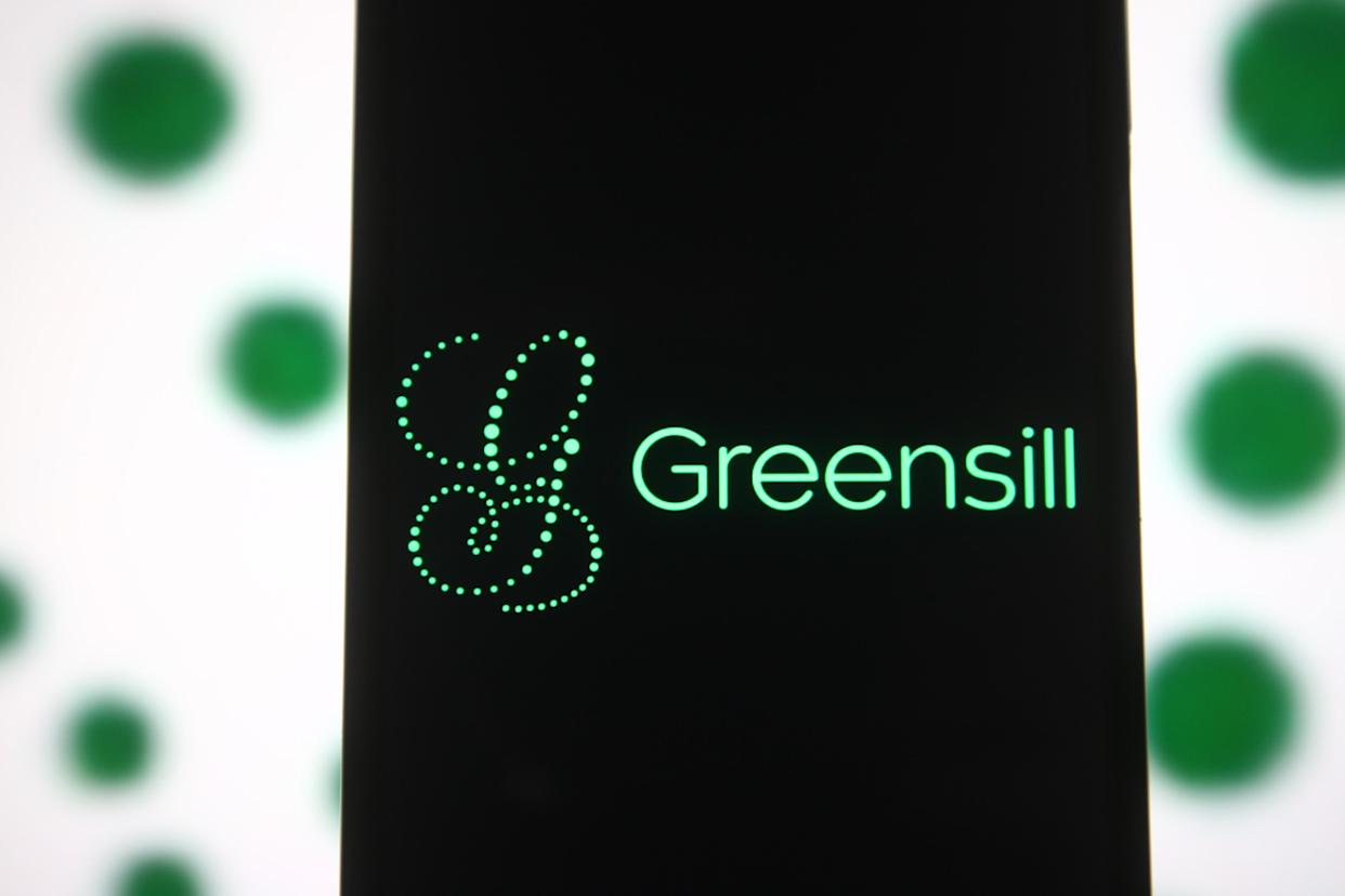 UKRAINE - 2021/04/04: In this photo illustration the Greensill logo of a Greensill Capital financial services company is seen on a smartphone and a pc screen. (Photo Illustration by Pavlo Gonchar/SOPA Images/LightRocket via Getty Images)