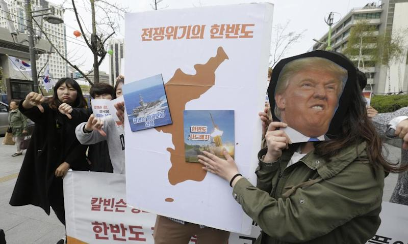 Protesters near the US embassy in Seoul in a rally against Donald Trump, 13 April 2017