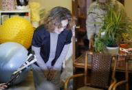 Junko Ishido, mother of Kenji Goto, who is a Japanese journalist being held captive by Islamic State militants, bows as she speaks to reporters at her house in Tokyo January 28, 2015. Jordan said on Wednesday it was willing to hand over Iraqi woman Sajida al-Rishawi jailed for her role in a 2005 suicide bomb attack if Jordanian pilot Muath al-Kasaesbeh captured by Islamic State was released. Kasaesbeh's fate was thought to be tied to that of Kenji Goto after a video was released on Tuesday purporting to show the Japanese national saying he had 24 hours to live unless Jordan released al-Rishawi. REUTERS/Yuya Shino (JAPAN - Tags: POLITICS CIVIL UNREST CRIME LAW)