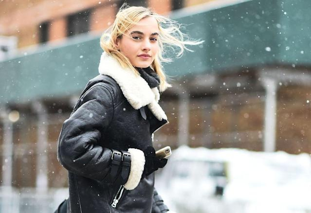 <p>A model wears a chic black-and-white shearling moto coat — the only one you'll need in your wardrobe to stay on top of your style game throughout the cold, winter months. You can easily pair it with trousers, jeans, or even leggings, and still look edgy. (Photo: Getty Images) </p>