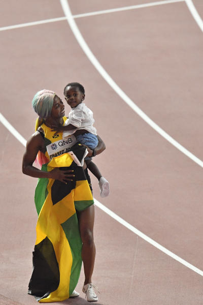 Shelly-Ann Fraser-Pryce, of Jamaica, celebrates after winning the gold medal in the women's 100 meter final during the World Athletics Championships in Doha, Qatar, Sunday, Sept. 29, 2019. (AP Photo/Martin Meissner)