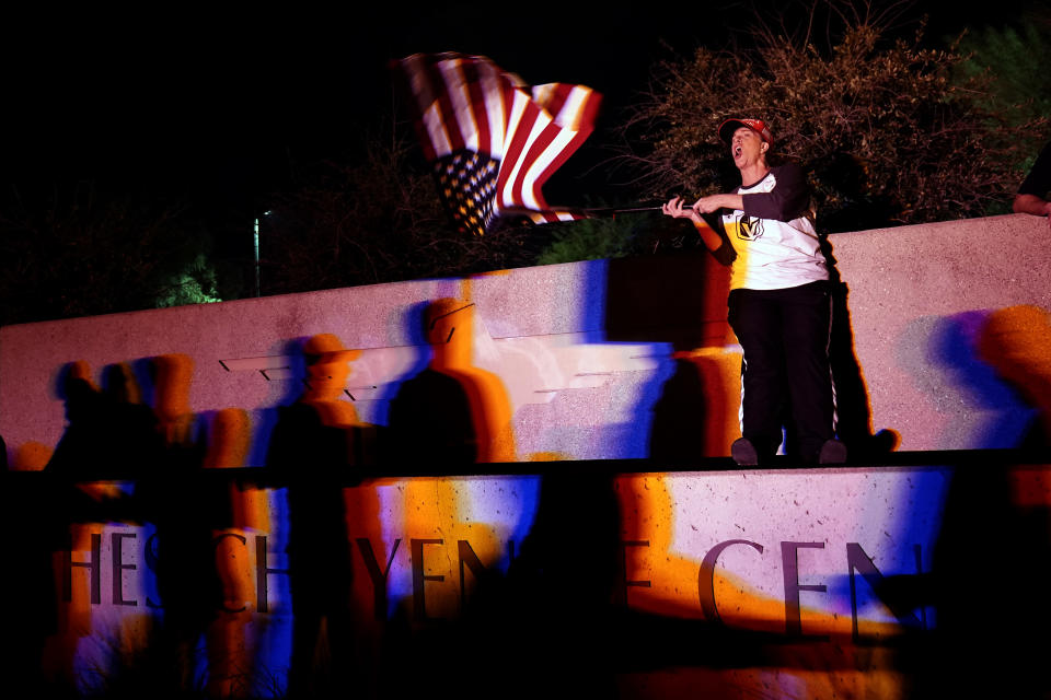 Debra Dudman waves a flag with other supporters of President Donald Trump as they protest in front of the Clark County Election Department on Thursday, Nov. 5, 2020, in Las Vegas, after the Nov. 3 elections. (AP Photo/Jae C. Hong)