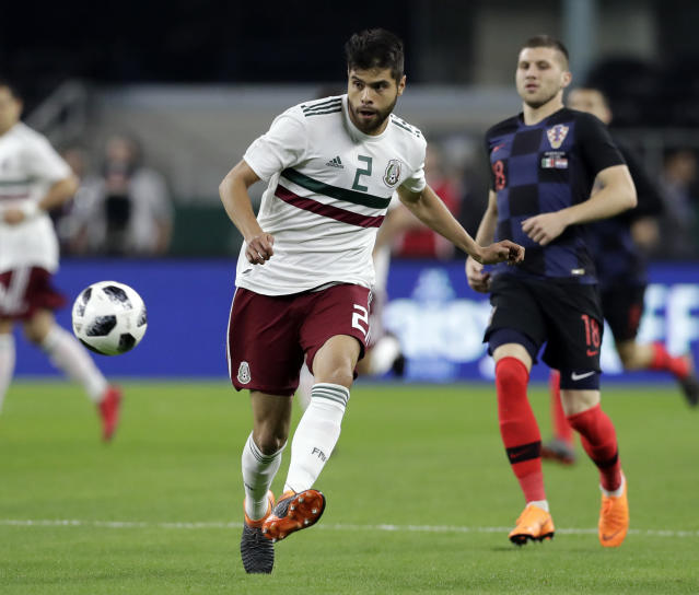 Mexico defender Nstor Araujo (2) passes the ball back to the goalie in the first half of a friendly soccer match as Croatia forward Ante Rebic (18) watches in Arlington, Texas, Tuesday, March 25, 2018. (AP Photo/Tony Gutierrez)