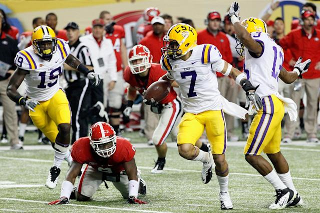 ATLANTA, GA - DECEMBER 03: Tyrann Mathieu #7 of the LSU Tigers returns a punt 62-yards for a touchdown in the second quarter against the Georgia Bulldogs during the 2011 SEC Conference Championship at Georgia Dome on December 3, 2011 in Atlanta, Georgia. (Photo by Kevin C. Cox/Getty Images)