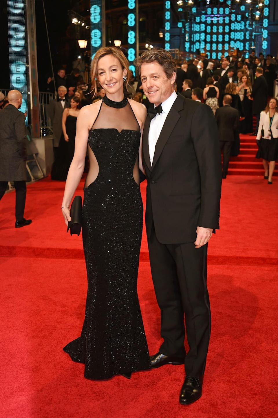 <p>Hugh's smart tux was perfectly matched by Anna's sheer sparkly gown. <i>[Photo: Getty]</i> </p>