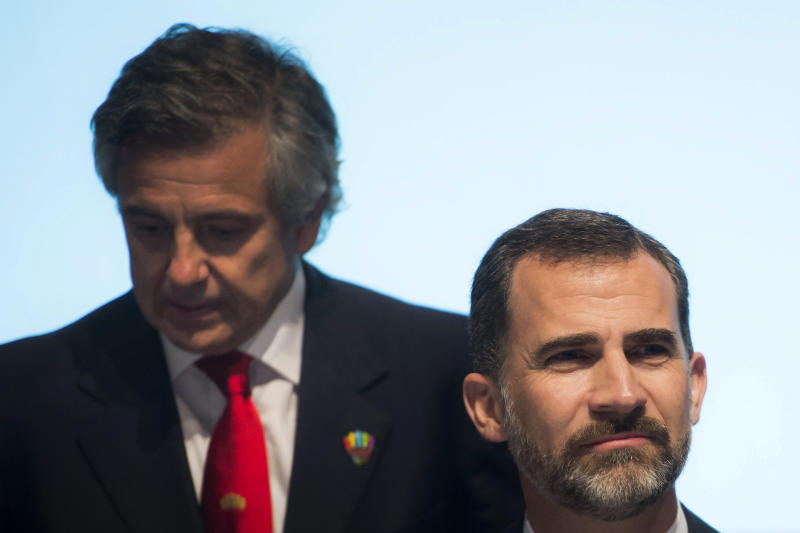 Spanish Crown Prince Felipe of Asturias, right, grimaces as he supports the Madrid 2020 Olympic Bid Committee next to Juan-Antonio Samaranch Jr., left, during the 2020 Candidate Cities Briefing for IOC Members during the first day of the International Olympic Committee, IOC, extraordinary Session, in Lausanne, Switzerland, Wednesday, July 3, 2013. Istanbul, Madrid and Tokyo were laying out their plans on Wednesday to the general assembly of the International Olympic Committee, the first time they have made presentations directly to the electorate. (AP Photo/Keystone, Jean-Christophe Bott)