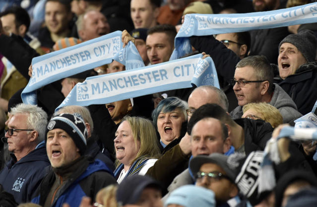 Manchester City fans support their team during the English Premier League soccer match between Manchester City and Manchester United at Etihad stadium in Manchester, England, Saturday, Dec. 7, 2019. (AP Photo/Rui Vieira)