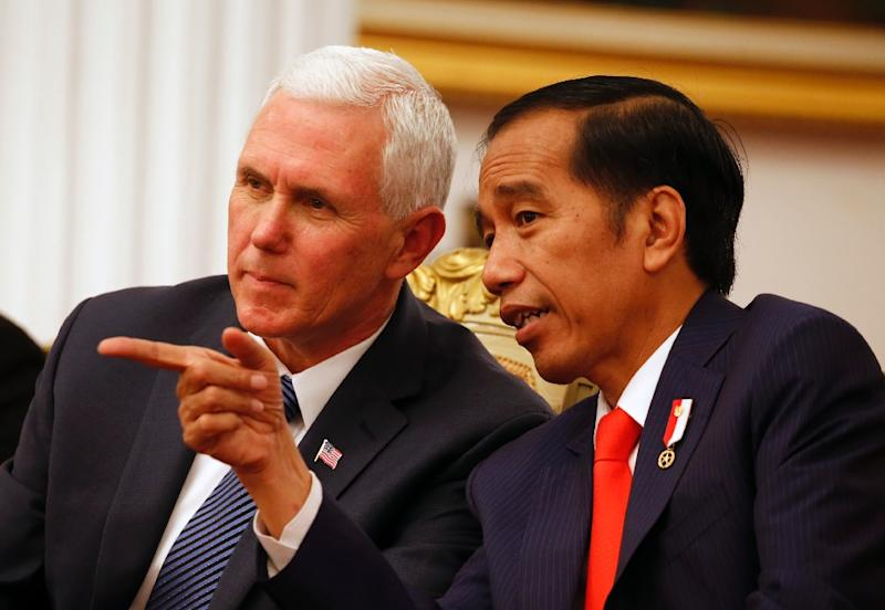 US Vice President Mike Pence (L) listens to Indonesian President Joko Widodo during their meeting at Merdeka Palace in Jakarta