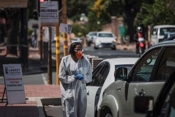 PHOTO: A health professional conducts tests for the novel coronavirus at a drive-through testing site outside the Lancet Laboratories facilities in Johannesburg, South Africa, on March 19, 2020. (Marco Longari/AFP via Getty Images)