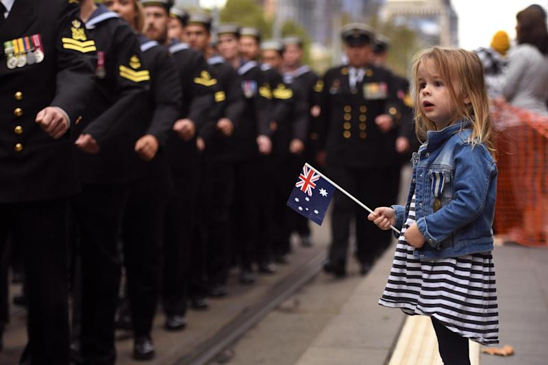 A young girl watches sailors march during the Anzac Day parade in Melbourne (AFP/Getty Images)