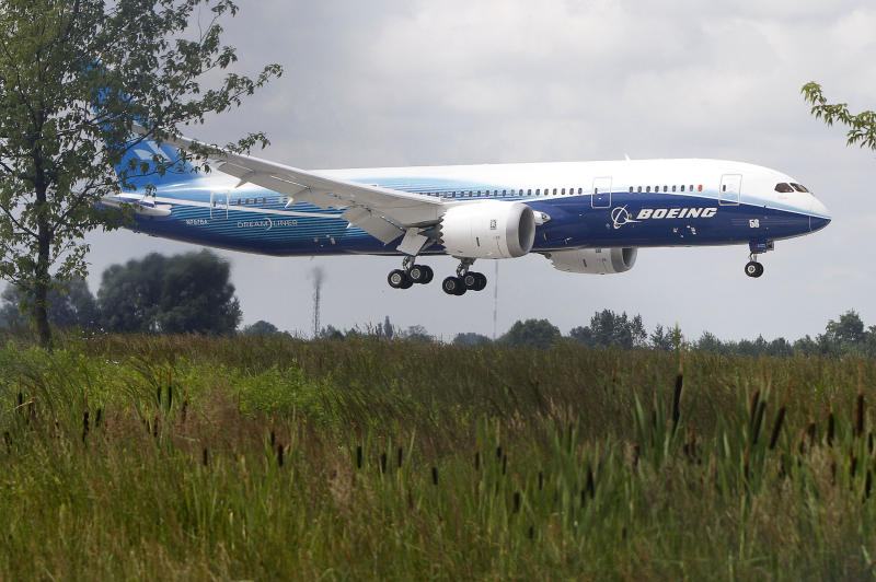 A Boeing 787 Dreamliner makes its very first landing at the Frederic Chopin airport in Warsaw, Poland on Friday, June 24, 2011. Warsaw is the first in Europe to host the Dreamliner, after it was showcased at the Paris Air Show.  The 787 is the first mid-size plane capable of flying long-range routes, which will allow airlines to open new, non-stop flights. (AP Photo/Czarek Sokolowski)