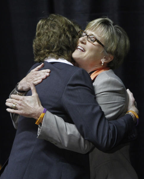 Former Tennessee women's college basketball coach Pat Summitt, left, hugs new head coach Holly Warlick during a news conference Thursday, April 19, 2012, in Knoxville, Tenn. Summitt stepped aside after 38 seasons, the last an emotionally draining farewell tour for the woman who won more games than anyone else in NCAA college basketball history. (AP Photo/Wade Payne)