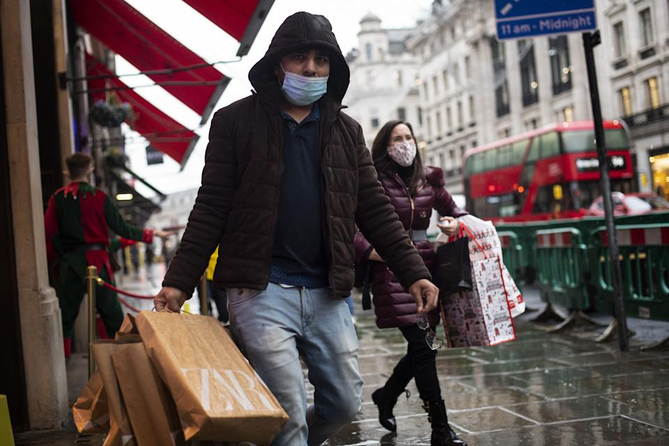 Shoppers wearing face masks in Regent Street, London, after the second national lockdown ended and England has a strengthened tiered system of coronavirus restrictions. (Photo by Victoria Jones/PA Images via Getty Images)