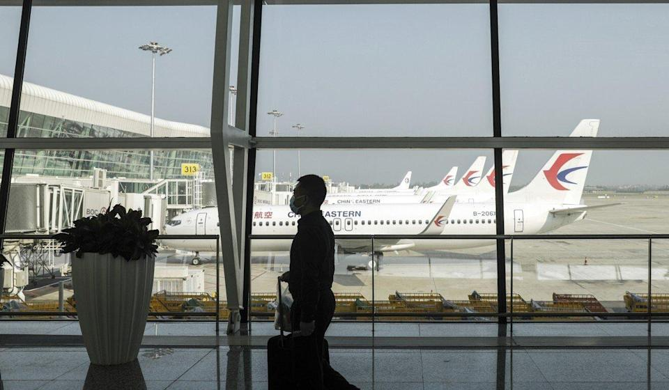 A passenger at Wuhan Tianhe International Airport. The Chinese mainland remains virtually closed off to non-residents. Photo: Bloomberg