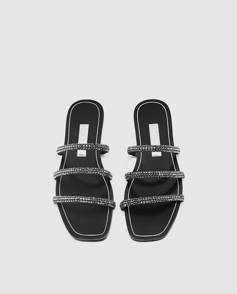 """<p>Everyone is wearing these tubular slides at the moment, and Zara are providing the goods with this rather glitzy pair. <em><a rel=""""nofollow noopener"""" href=""""https://www.zara.com/uk/en/slides-with-shiny-tubular-straps-p12646301.html?v1=5502012&v2=711022"""" target=""""_blank"""" data-ylk=""""slk:Buy here."""" class=""""link rapid-noclick-resp"""">Buy here.</a></em> </p>"""