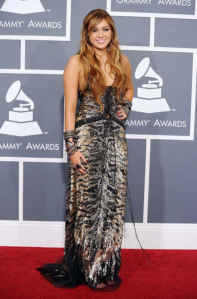 5. Miley Cyrus -- in a sequined Roberto Cavalli creation, honey-colored tresses, and stacked bangles -- at the 53rd Annual Grammy Awards. (02/13/2011)