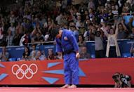 London's ExCel Centre erupted in boos of derision when South Korea's Cho Jun-ho was judged to have beaten Japan's Masashi Ebinuma after a close judo encounter. Startled judges referred their decision to a reviewing jury, which took the unprecedented step of overturning the result. South Korea's Cho Jun-Ho (blue) bows to the judges before leaving the mat area after losing to Japan's Masashi Ebinuma in the men's —66kg quarter— final judo match at the London 2012 Olympic Games July 29, 2012.