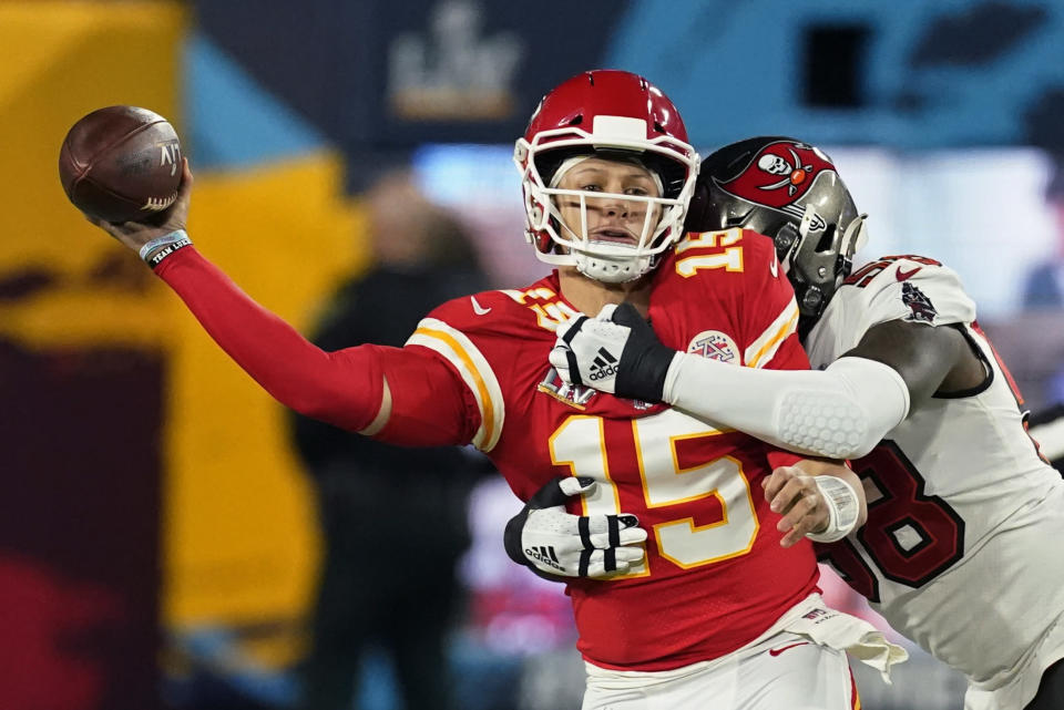 Kansas City Chiefs quarterback Patrick Mahomes passes under pressure from Tampa Bay Buccaneers outside linebacker Shaquil Barrett during the first half of the NFL Super Bowl 55 football game Sunday, Feb. 7, 2021, in Tampa, Fla. (AP Photo/Ashley Landis)