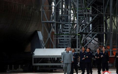 <span>North Korean leader Kim Jong Un visits a submarine factory in an undisclosed location, North Korea</span> <span>Credit: Reuters </span>