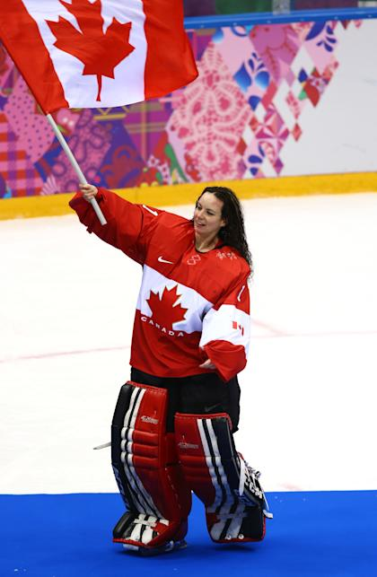 SOCHI, RUSSIA - FEBRUARY 20: Shannon Szabados #1 of Canada celebrates after defeating the United States 3-2 in overtime during the Ice Hockey Women's Gold Medal Game on day 13 of the Sochi 2014 Winter Olympics at Bolshoy Ice Dome on February 20, 2014 in Sochi, Russia. (Photo by Doug Pensinger/Getty Images)