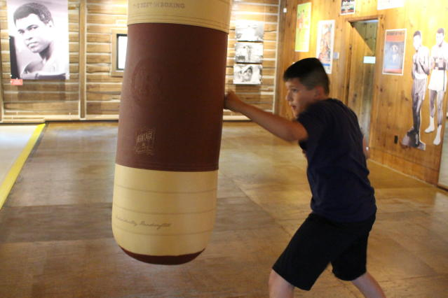 Benny Quiles-Rosa punches the heavy bag in the gym at Fighters Heaven, Muhammad Alis training camp in Deer Lake, Pa., Saturday June 8, 2019. The newly renovated camp is open to the public on weekends. (AP Photo/Michael Rubinkam)