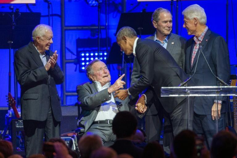 (L-R) Former US presidents Jimmy Carter, George H.W. Bush, Barack Obama, George W. Bush and Bill Clinton attend a hurricane relief concert in Texas in October 2017