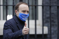 Britain's Health Secretary Matt Hancock leaves Downing Street in London, Wednesday, Dec. 2, 2020. U.K. Health Secretary Matt Hancock on Wednesday thanked scientists from Pfizer and BioNTech after the approval of their COVID-19 vaccine for emergency use by the country's drugs regulator. Speaking earlier Hancock gave details of how the vaccine would be distributed from the beginning of next week. (AP Photo/Kirsty Wigglesworth)
