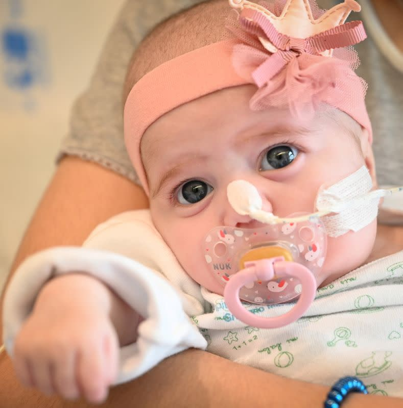 Two-month old Spanish baby girl Naiara, who received a heart transplant in a pioneering surgery, is seen in this handout picture released by Gregorio Maranon Hospital in Madrid