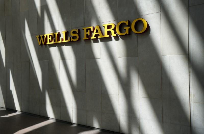 The sign outside the Wells Fargo & Co. bank in downtown Denver
