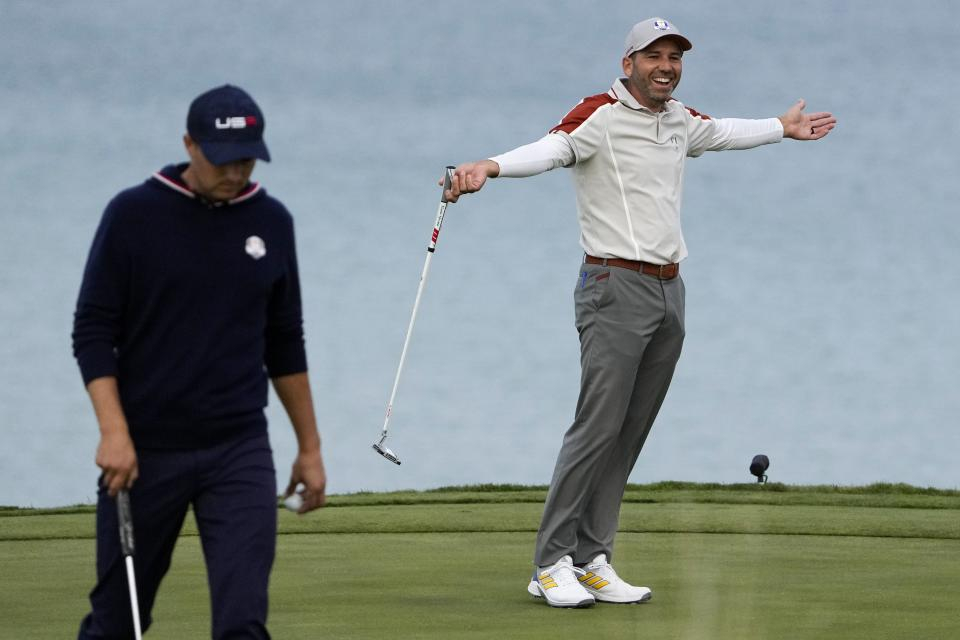 Team Europe's Sergio Garcia reacts after teammate Team Europe's Jon Rahm makes a putt during a four-ball match the Ryder Cup at the Whistling Straits Golf Course Saturday, Sept. 25, 2021, in Sheboygan, Wis. (AP Photo/Jeff Roberson)
