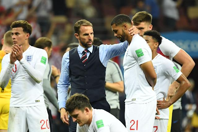 England manager Gareth Southgate consoles one of his many young players, Ruben Loftus-Cheek, after his team's 2-1 World Cup semifinal loss to Croatia. (Getty)
