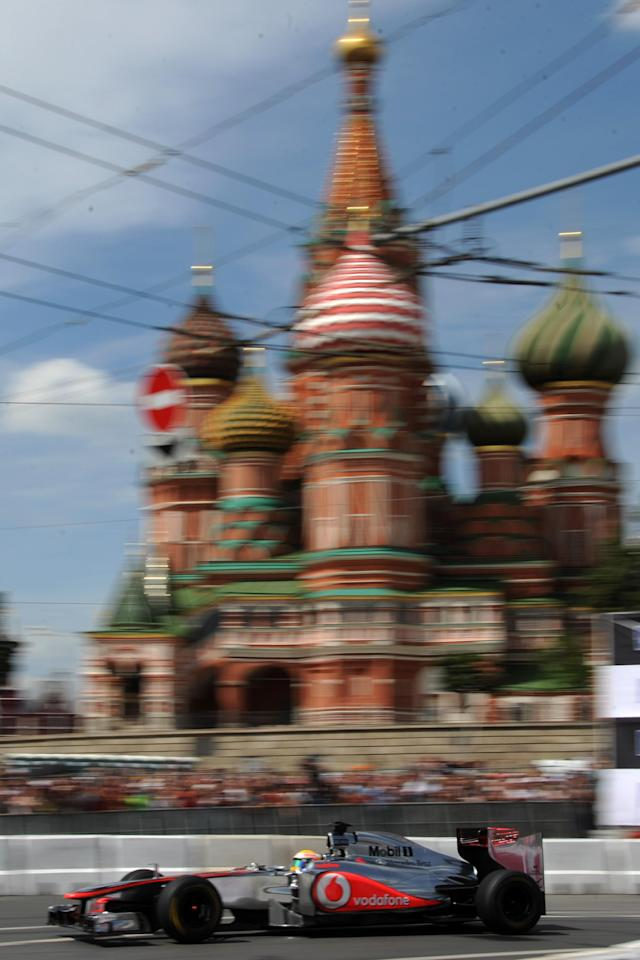 """Formula One McLaren Mercedes' British driver Lewis Hamilton speeds past St. Basil's Cathedral during the """"Moscow City Racing"""" show on July 15, 2012 in central Moscow. AFP PHOTO / KIRILL KUDRYAVTSEVKIRILL KUDRYAVTSEV/AFP/GettyImages"""