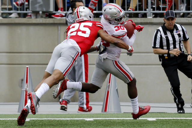 Ohio State defensive back Brendon White, left, tackles receiver Demario McCall during their NCAA college spring football game Saturday, April 14, 2018, in Columbus, Ohio. (AP Photo/Jay LaPrete)
