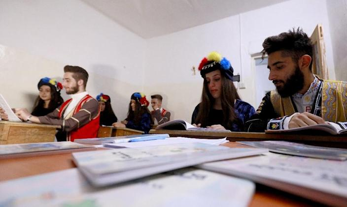 Students from the Syriac Christian minority attend a class in Qamishli (AFP Photo/Delil souleiman)