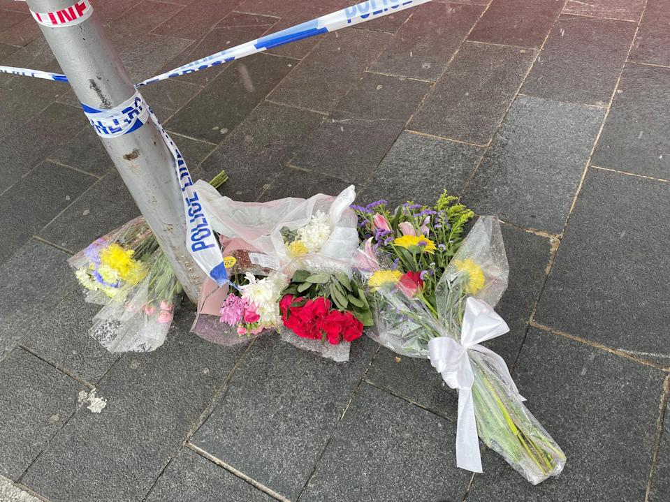 Flowers left near the scene at Woolwich New Road (PA Wire)