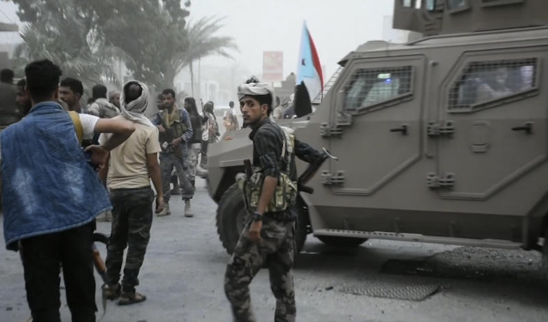 In this Friday Aug. 9, 2019 frame grab from video, Southern Transitional Council separatist fighters prepare to storm the presidential palace in the southern port city of Aden, Yemen. The separatists backed by the United Arab Emirates began withdrawing Sunday from positions they seized from the internationally-recognized government in Aden. Both the southern separatists and the government forces are ostensibly allies in the Saudi-led military coalition that's been battling the Houthi rebels in northern Yemen since 2015, but the four days of fighting in Aden have exposed a major rift in the alliance. (AP Photo)