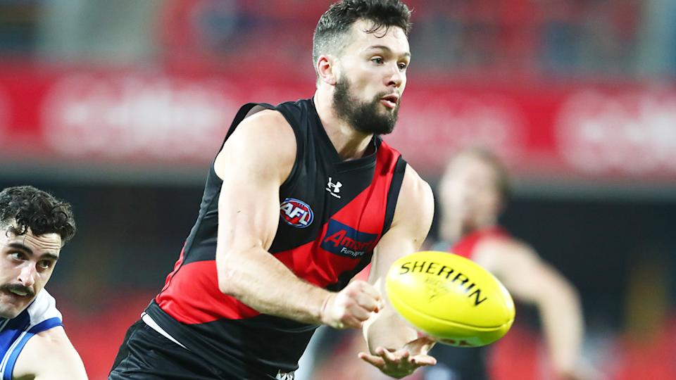 Conor McKenna, pictured here in action for Essendon against North Melbourne in the AFL.