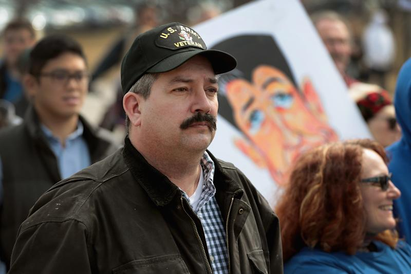 """Democrat Randy """"IronStache"""" Bryce participates in the March for Our Lives rally for greater gun regulation in Janesville, Wisconsin, on March 28, 2018. (Scott Olson/Getty Images)"""