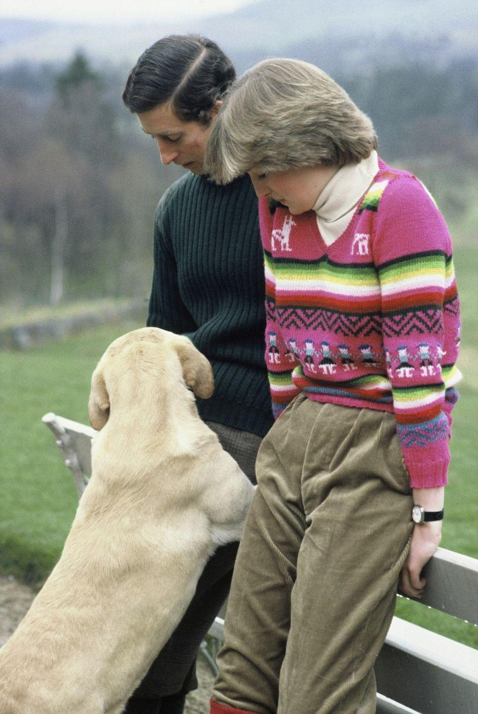 <p>Prince Charles and his fiancée, the future Princess Diana, spend time with his dog at on the Balmoral Estate.</p>