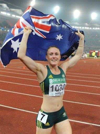 Australia's Sally Pearson celebrates her win in the women's 100m hurdles final of the Track and Field competition of the XIX Commonwealth games, in October 2010, in New Delhi. Pearson believes she is a more confident hurdler since becoming world champion, and is adamant she will handle the daunting pressure as the gold medal favourite at the London Games
