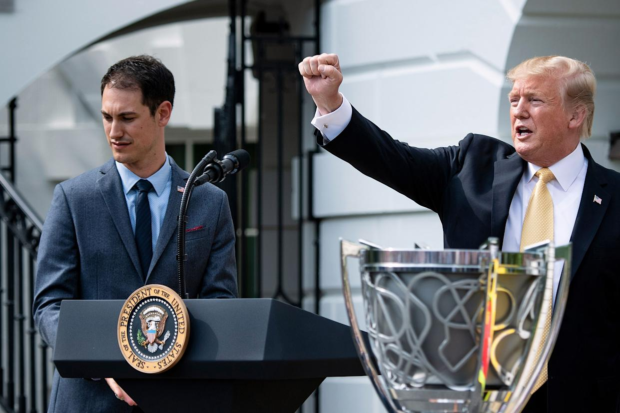 2018 NASCAR Cup Series Champion Joey Logano listens while US President Donald Trump speaks during an event on the South Lawn of the White House  April 30, 2019, in Washington, DC. (Photo by Brendan Smialowski / AFP)        (Photo credit should read BRENDAN SMIALOWSKI/AFP via Getty Images)