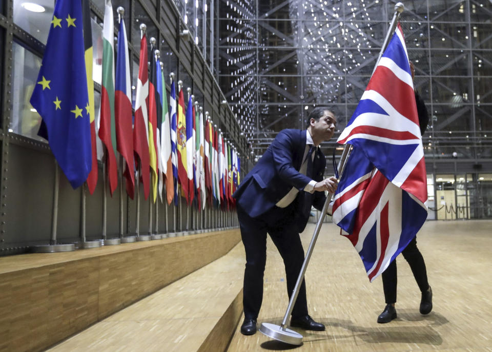 The Union flag is removed from the atrium of the Europa building in Brussels. (AP)