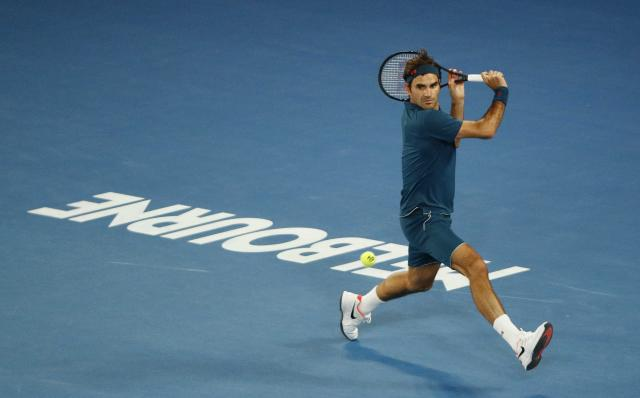 Tennis - Australian Open - Fourth Round - Melbourne Park, Melbourne, Australia, January 20, 2019. Switzerland's Roger Federer in action during the match against Greece's Stefanos Tsitsipas. REUTERS/Edgar Su