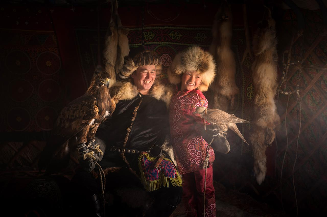<p>Daniel, from Moscow, learned that the hunters train eagles from an early age and look after the majestic birds until they are 12 years of age. (Photo: Daniel Kordan/Caters News) </p>
