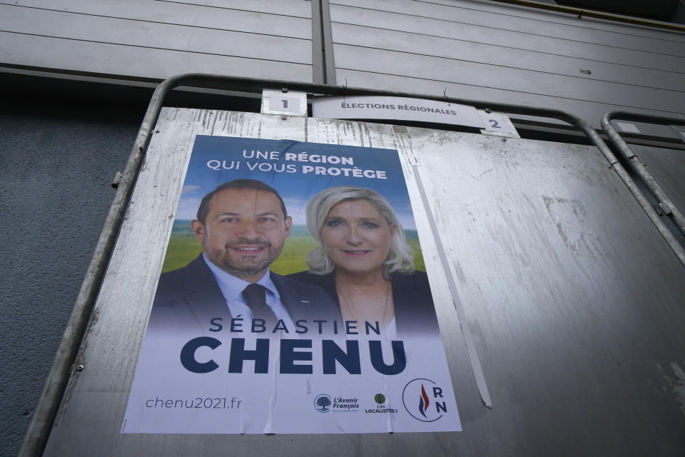 Electoral campaign boards for northern France region with local candidate Steeve Briois and Marine Le Pen, French far- right leader, in Henin-Beaumont, northern France, Friday, June 25, 2021. Marine Le Pen's far right party is riding high on her tough-on-security, stop-immigration message as French voters start choosing regional leaders Sunday in an election that's seen as a dress rehearsal for next year's presidential vote. AP Photo/Michel Spingler)