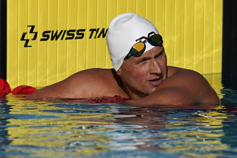 FILE - In this April 8, 2021, file photo, Ryan Lochte pauses after competing in the men's 200-meter freestyle preliminary race at the TYR Pro Swim Series swim meet in Mission Viejo, Calif. Lochte, the swimmer who embarrassed himself and the U.S. five years ago in Rio de Janeiro, is seeking to make a record-tying Olympic team. (AP Photo/Ashley Landis, File)